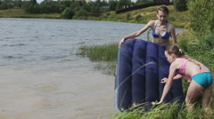 Happy family has a rest on the lake in the summer. Stock Footage