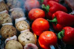 Veggies on barbeque tomatoes, red bell pepper, potatoes - stock photo