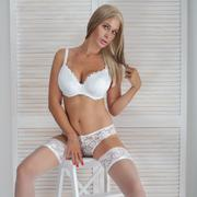 Sensual blonde lady posing in lingerie. - stock photo