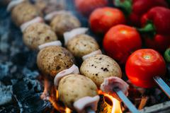 Veggies on barbeque tomatoes, red bell pepper, potatoes Stock Photos