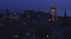 An establishing shot of Edinburgh, Scotland at night. Stock Footage
