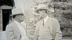 1937: Elite businessmen in formal fashion dress with fedora hats. Stock Footage