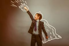 Superhero boy raised his hands superpower businessman flying beh Stock Photos