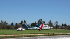 Air Ambulance lifts off scene of crash Stock Footage