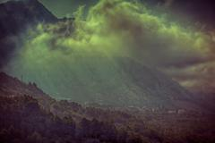 Mystical mountain's village landscape with fog. - stock photo