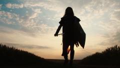 Swordsman walking towards camera in slowmotion.  Stock Footage