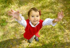 Little girl giving a hug - stock photo