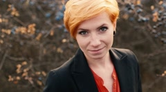 The red-haired model posing in camera - stock footage