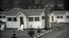 1937: White cabin country living residential community summer getaway. Stock Footage