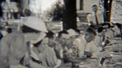 1937: Outdoor family reunion picnic gathering of local heros. - stock footage