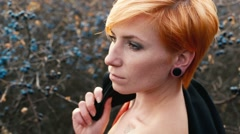 Red-haired woman with bare shoulders posing for a photograph Stock Footage