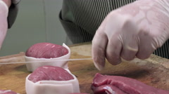 A butcher manufactures veal roulades Stock Footage