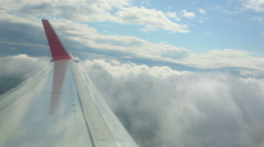 The aircraft is climbing and turning, flying through the clouds Stock Footage