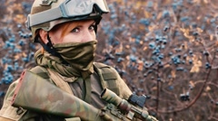 A woman soldier with a weapon Stock Footage