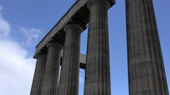 An establishing time lapse shot of the Roman columns in Edinburgh, Scotland at Stock Footage
