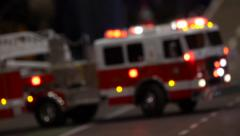 Fire trucks parked in a street background - unfocused style of the camera Stock Footage
