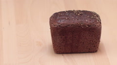 Cutting rye bread. Stock Footage