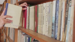 Long hall of library with wooden bookcases - stock footage
