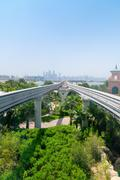 Elevated, Monorail Train Tracks Stretching towards a Metropolitan Cityscape - stock photo