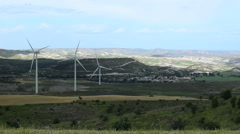 Stock Video Footage of Huge wind turbine propellers rotate in green valley, generate alternative energy