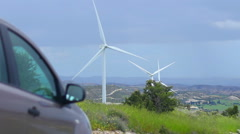Stock Video Footage of Car standing near wind farm, alternative power sources, fuel cost, energy crisis