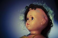 Head of beatiful scary doll like from horror movie - evil face, grunge, macro Stock Photos