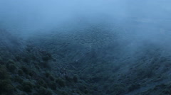 Thick fog covering mountains in darkness, mysterious atmosphere, horror film Stock Footage