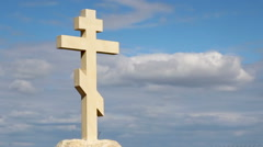 Stock Video Footage of Orthodox stone cross against blue sky background, belief in God, religion