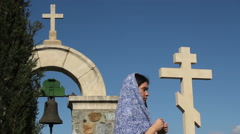 Stock Video Footage of Religious woman praying to God. Monastery, stone crosses, solitude, spirituality