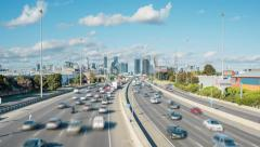 4k timelapse video of highway traffic congestion and cbd of a city Stock Footage