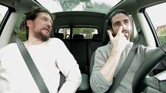 Two men in car driving discussing about problems Stock Footage