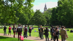 Pedestrians walk in St. James Park in London with Big Ben background. Stock Footage