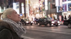 Girl looking at Ginza Buildings Tokyo Stock Footage