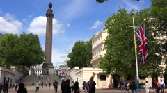 An establishing shot of Trafalgar Square, London England on a sunny day. - stock footage