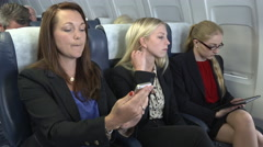 Female business team make video call on plane Stock Footage
