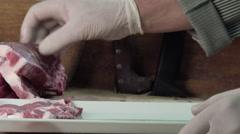 Cutting pork ribs Stock Footage