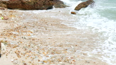 Beautiful nature seascape with the wave into the rock on the beach Stock Footage