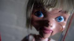 Puppet swinging on strings toward camera - stock footage
