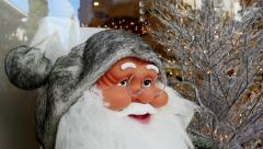 Santa Claus smiling statue wearing glasses - stock footage