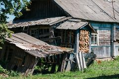 Destroyed wooden house in village - stock photo