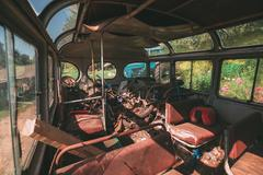 Interior of an old city transit bus - stock photo