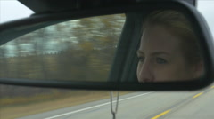 Woman's Face Eyes In Car Rear View Mirror While Driving Hand Held Stock Footage