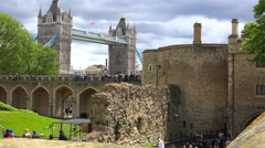 The Tower Bridge in London England is seen from the perspective of the Tower Of Stock Footage