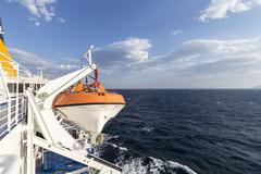 Lifeboat on the port side of the ship Stock Photos