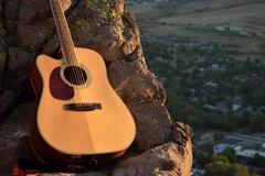 Bright Acoustic Guitar in the Mountains - stock photo