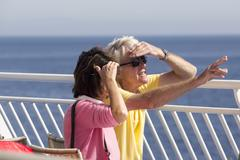 Tourists on the deck of a ship heading to Santorini island, in Greece. Stock Photos
