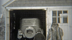 1938: During winter, family getting car from garage and backing up. Stock Footage