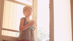 A little girl holds open a screen door and her dog accidentally gets out Stock Footage