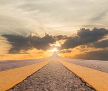 Road asphalt suspended to sunset - stock photo