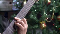 Playing guitar,close-up,on the Christmas tree Stock Footage